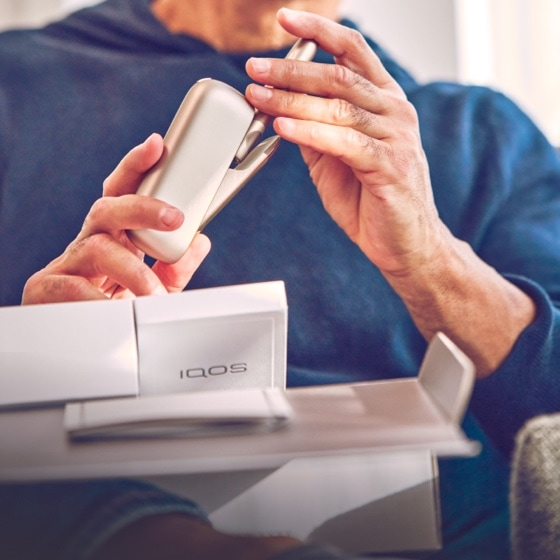 Man unboxing a new IQOS 3 DUO